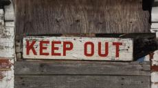 Image of a keep out sign on a building