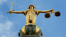 Lady Justice, holding scales and a sword, on top of the Central Criminal Court, also referred to as Old Bailey, in central London.