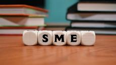 An image of the letters SME displayed on wooden blocks