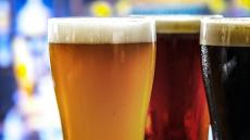 A close-image of three pints of beer