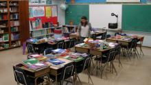 Teacher prepares classroom - Bart Everson