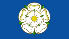 An image of the Yorkshire flag, featuring a White rose of York on a blue background