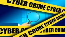 An illustration of yellow police tape bearing the text 'Cyber crime' and a magnifying glass