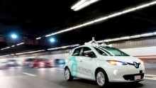 An image of a nuTonomy autonomous vehicle driving around Boston at night