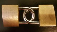 An image of two padlocks locked together