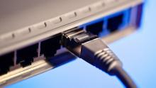 A close-up image of an Ethernet cable plugged into a router
