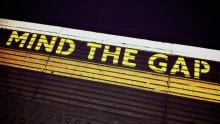 An image of the words 'Mind the gap' on a London Underground station platform