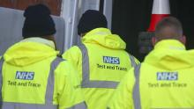 An image of workers wearing yellow high-visibility 'NHS Test and Trace' jackets