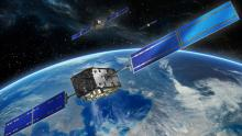 A CGI image of three Galileo satellites orbiting earth
