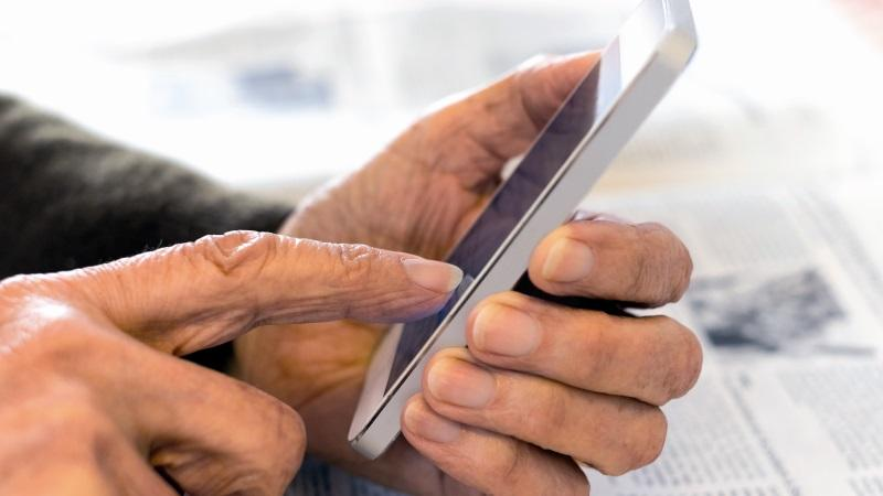 Old person using a smartphone