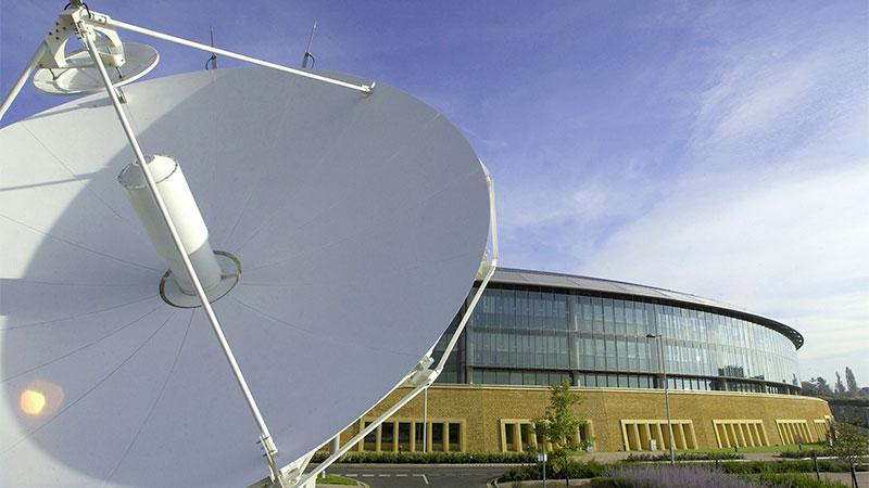 An image showing a satelitte and a building