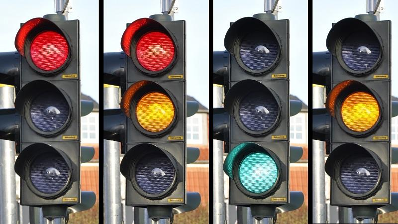 An image of traffic lights showing various stages