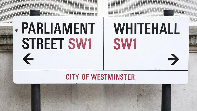 An image of a street sign directing people to Parliament Street and Whitehall, respectively