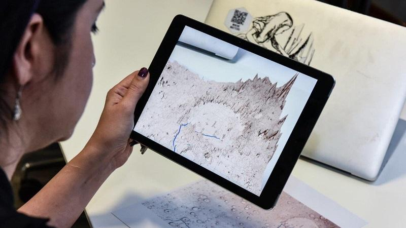 Image of a tablet screen displaying Ordnance Survey's augmented reality app of Mars