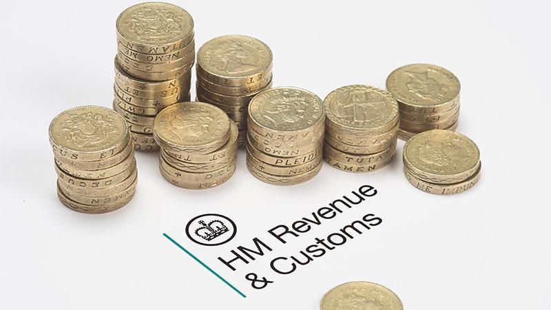 The HMRC logo surrounded by pound coins