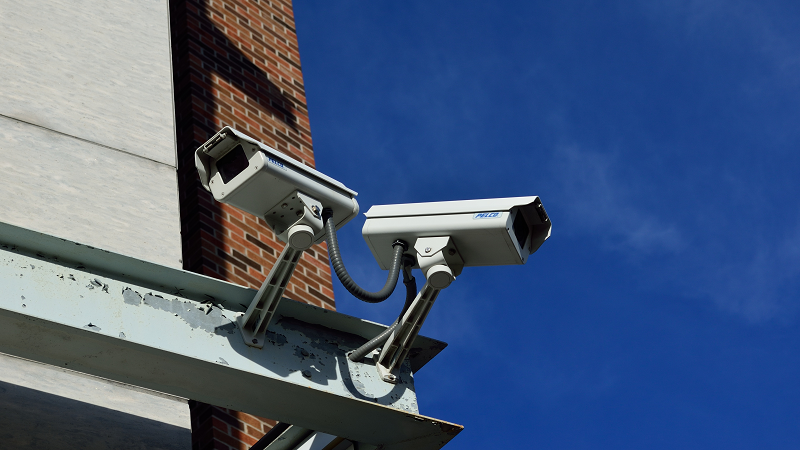 An image of two surveillance cameras