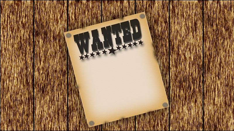 Image of a wanted poster on wood background