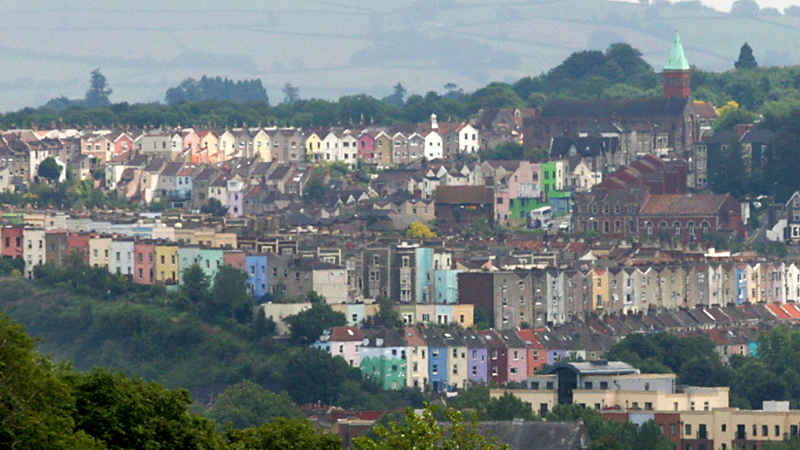 An image of the Bristol skyline with colourful roofs of houses