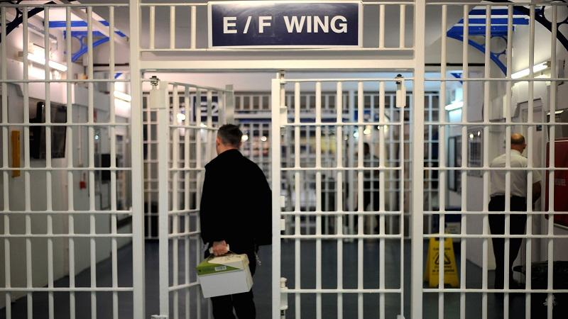 An image of a prison officer entering a wing