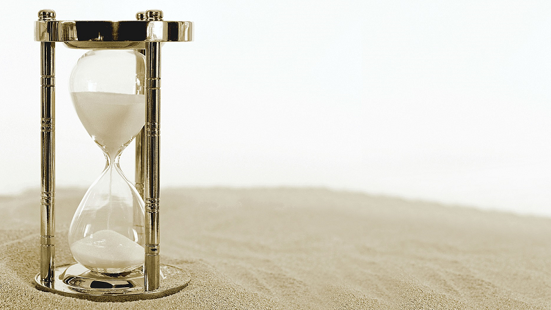 Image of an hourglass on sand