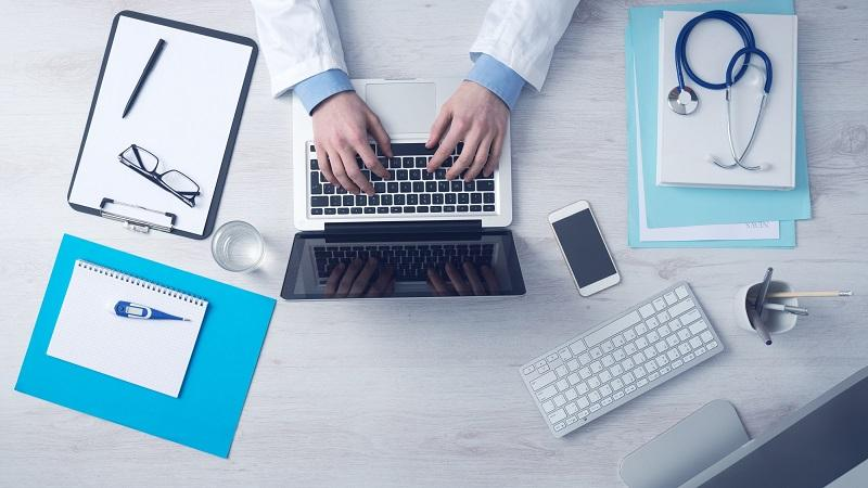 Image of a doctor using computer