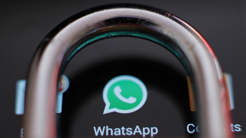 An image of the WhatsApp logo surrounded by a padlock