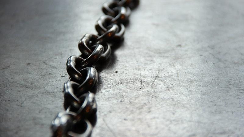 Image of a metal chain lying atop a surface