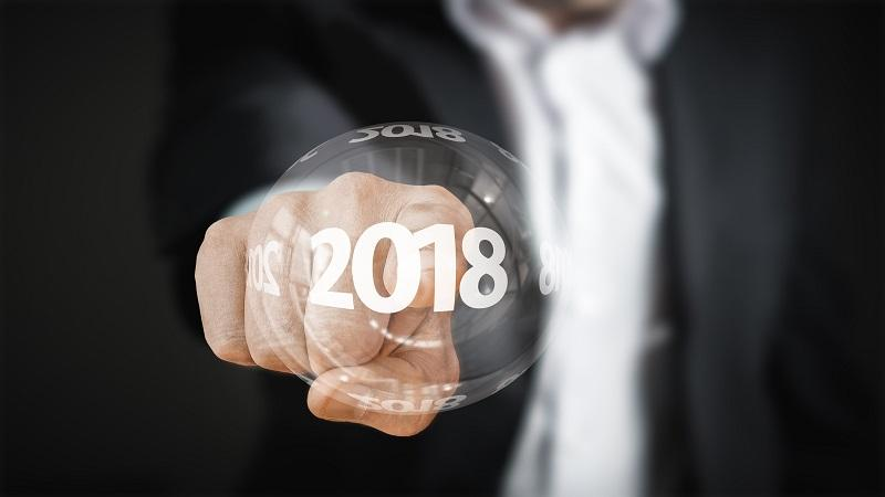 Image of a man pointing to a bubble containing the text '2018'