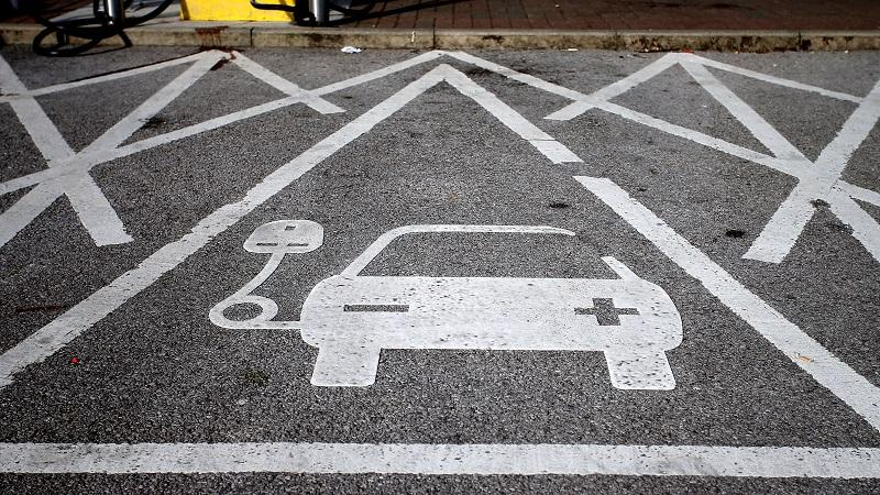 Image of markings on the floor indicating an electric-car charging point located at Chester services