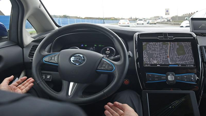 Image of a Nissan Leaf prototype driverless car being travelling around the streets of east London