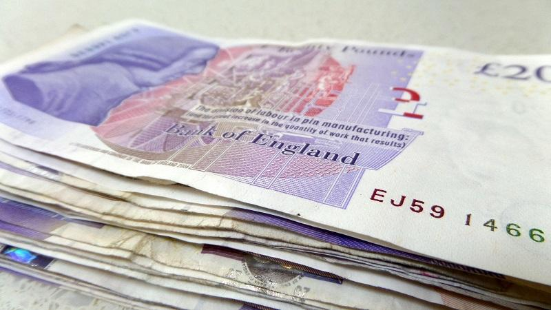 Close-up image of pile of £20 notes