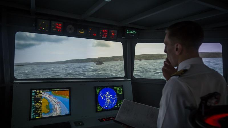 An image of a ship bridge simulator in use by a member of the Royal Navy at HM Naval Base Clyde