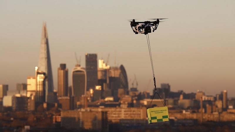 An image of a drone carrying medical supplies flying over London