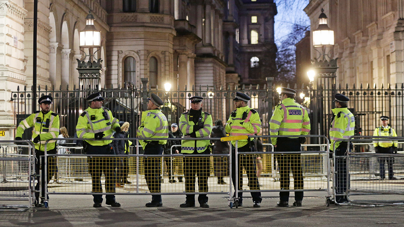 Police officers standing outside Downing Street, London