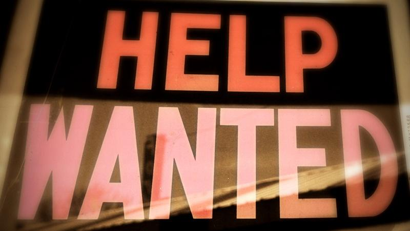 Image of a 'help wanted' sign