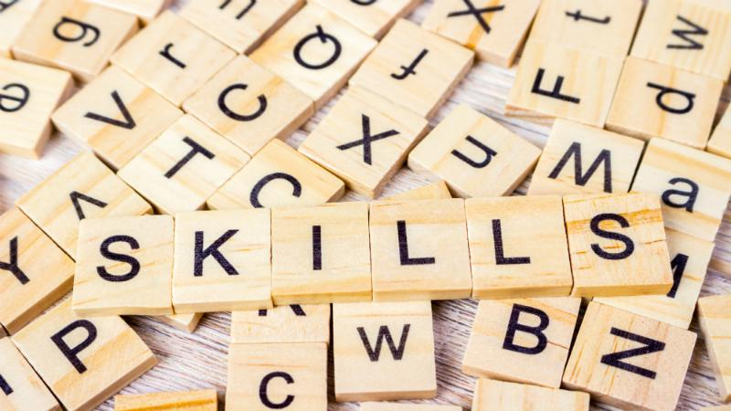 Skills Word Written In Wooden Cube. Wooden Cube Background