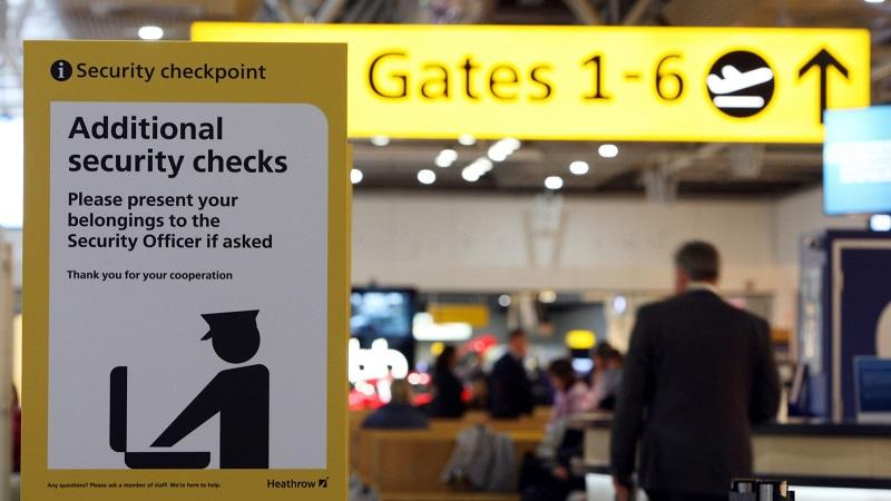 Image of an airport sign advising travellers of potential additional security checks