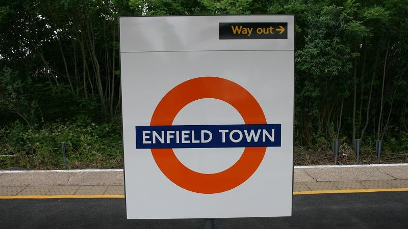 An image of a sign at Enfield Town station