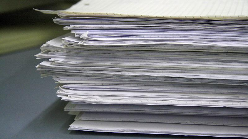 A close-up image of a pile of paper