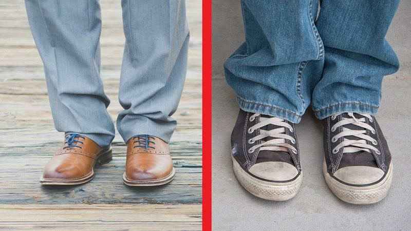 An image of a man wearing smart shoes and trousers and a person wearing scuffed trainers and jeans. The two are separated by a red line