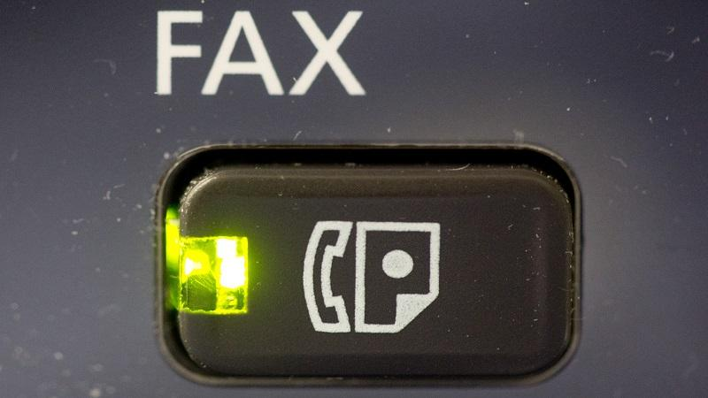A close-up image of a button marked 'fax'