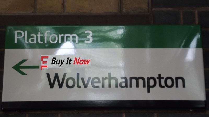 An image of a sing directing people to 'Trains to Wolverhampton' , with an eBay-style 'But It Now' text