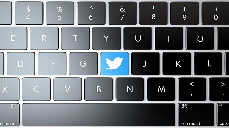 An image of a keyboard with one key bearing the Twitter logo