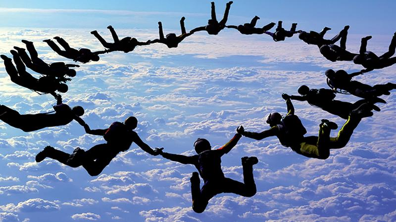 Team of skydivers in the air