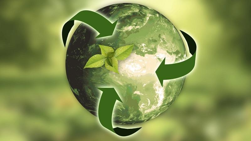 An illustration of a green globe encircled by arrows alluding to sustainability