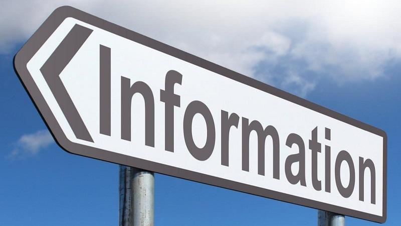 An image of a road sign pointing the way towards 'Information'