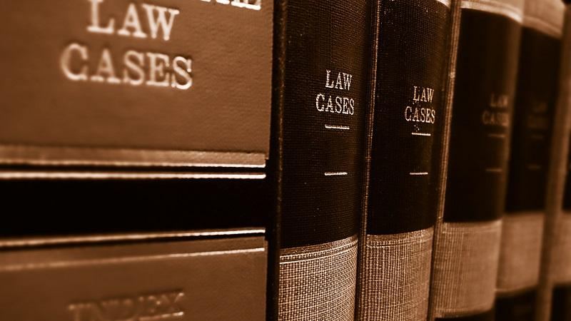 A close-up image of law books on a shelf