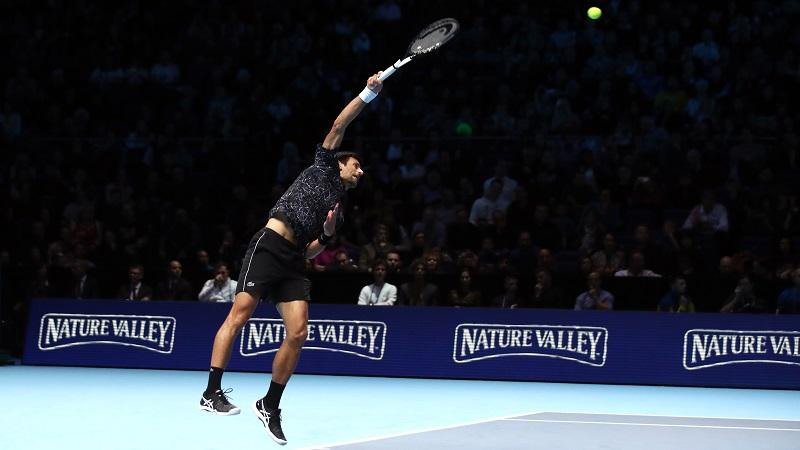 An image of Novak Djokovic serving during the final of the 2018 ATP Finals tournament at London's O2