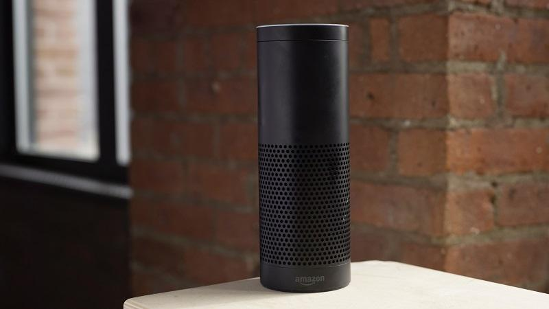 An image of an Amazon Echo smart speaker sitting on a countertop