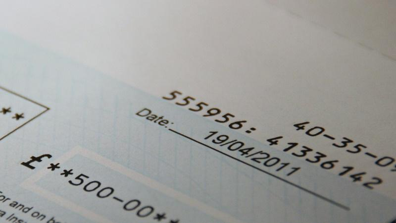 Close-up image of a £500 cheque from an unspecified payer